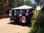 """God Runs Africa"" claims the T-shirt sold by this vendor in the downtown open air mall of Gaborone."
